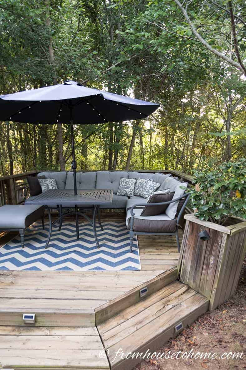 Place seating along 2 sides of a small patio or deck