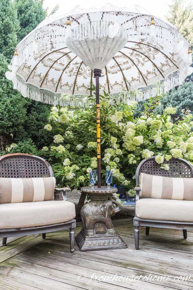 A really pretty umbrella makes a focal point for a small deck