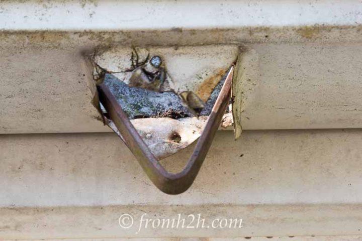 A rain chain bracket in the gutter
