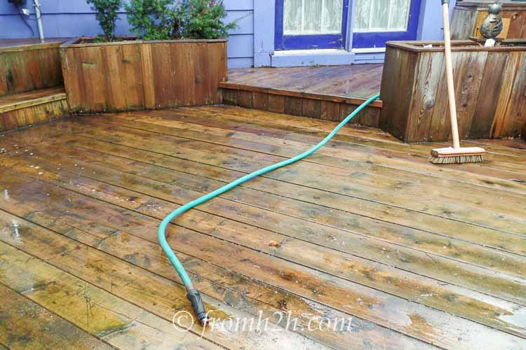 Wet the deck and scrub with a long handled brush | How To Get Your Garden Ready For Spring