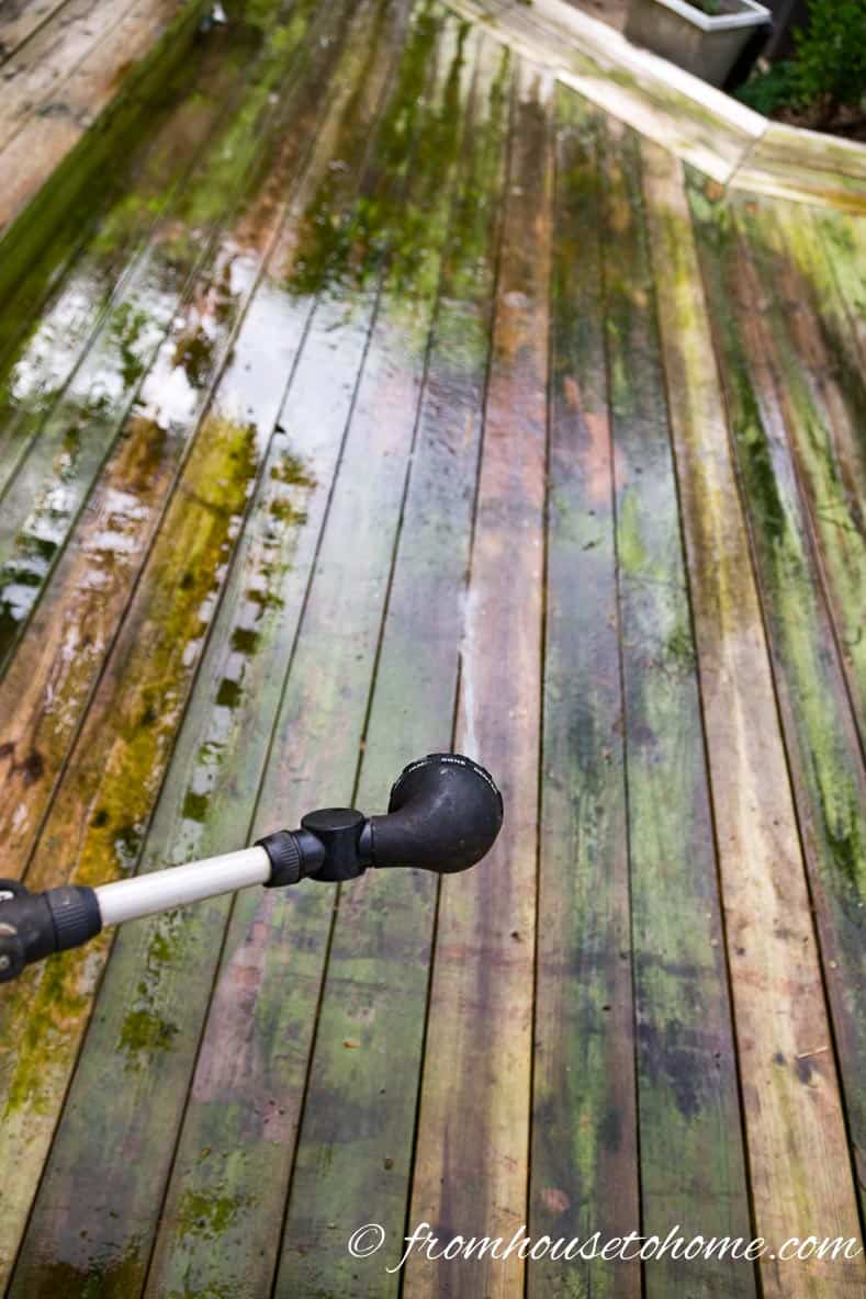 Soak the deck with a hose before starting | The Best (Inexpensive and Eco-Friendly) Homemade Deck Cleaner Ever!