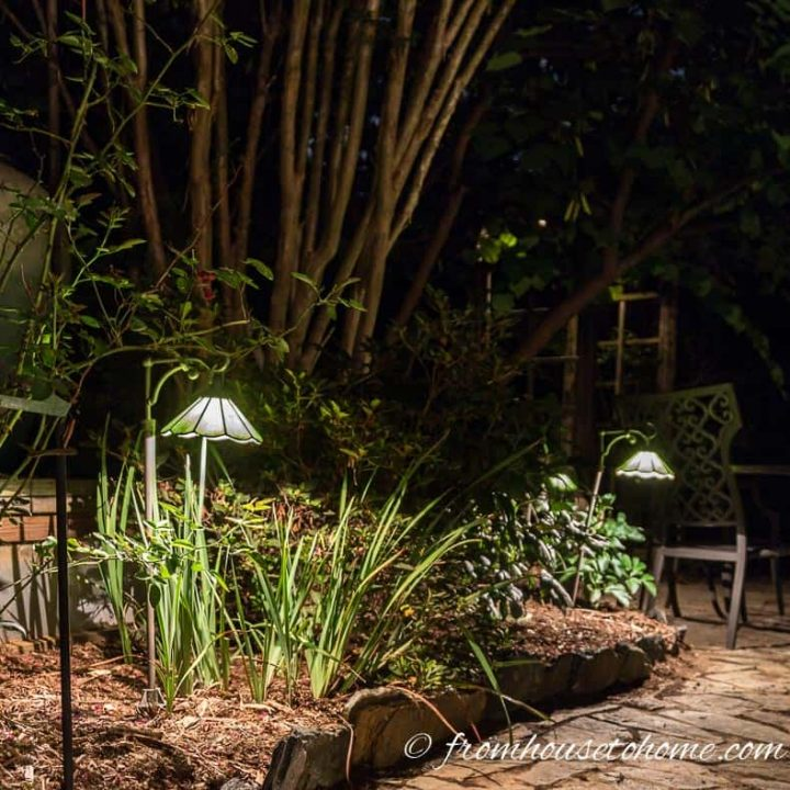 Path landscape lights installed around a patio