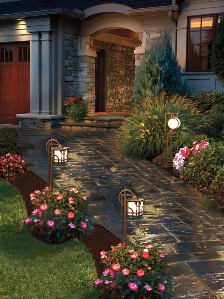 Low voltage landscape lights can make a house look magical at night, via diynetwork.com | 10 Beautiful Ways To Light Your Garden
