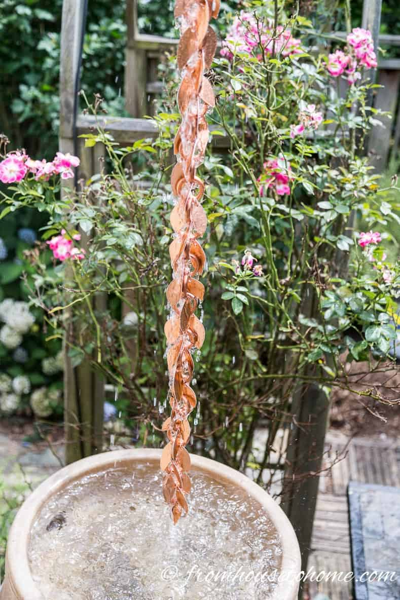 The installed rain chain above a rain barrel