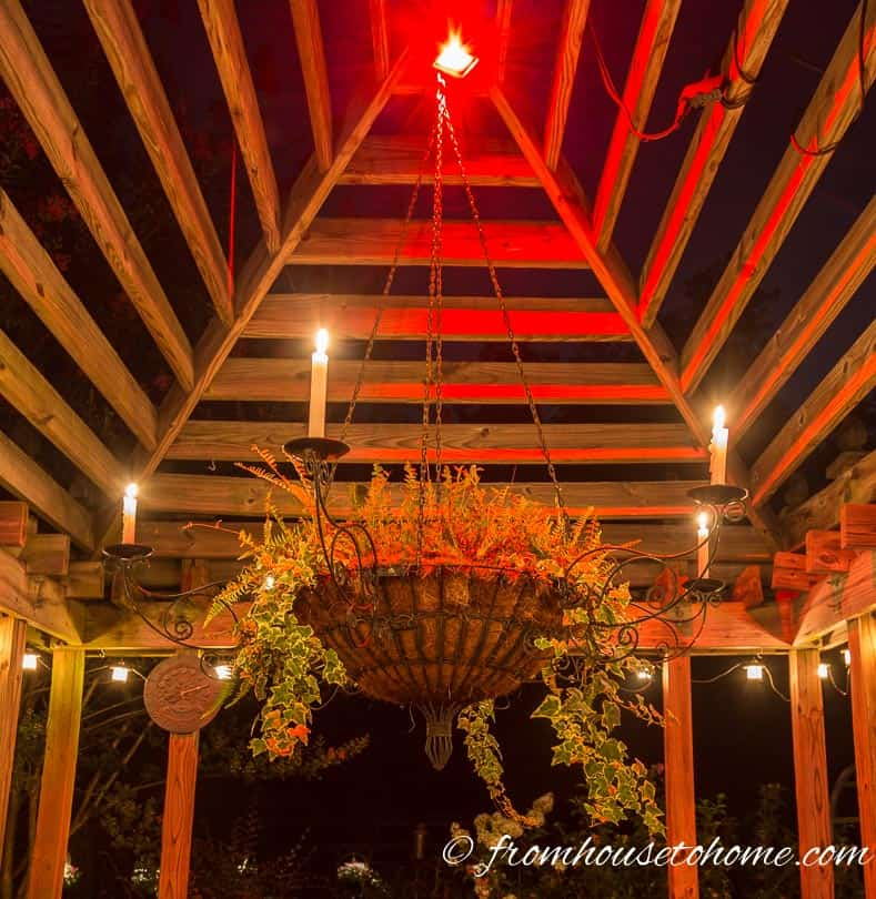 A flood light installed at the top of the gazebo provides general mood lighting | 10 Beautiful Ways To Light Your Garden