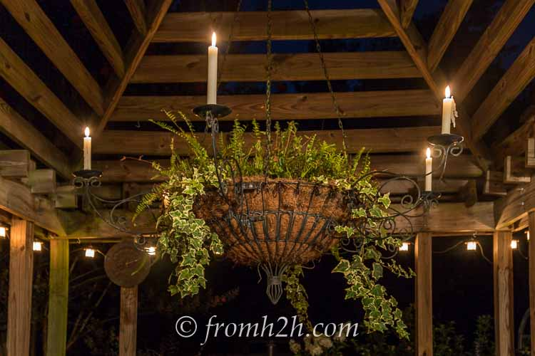 An outdoor candle chandelier adds ambiance | 10 Beautiful Ways To Light Your Garden