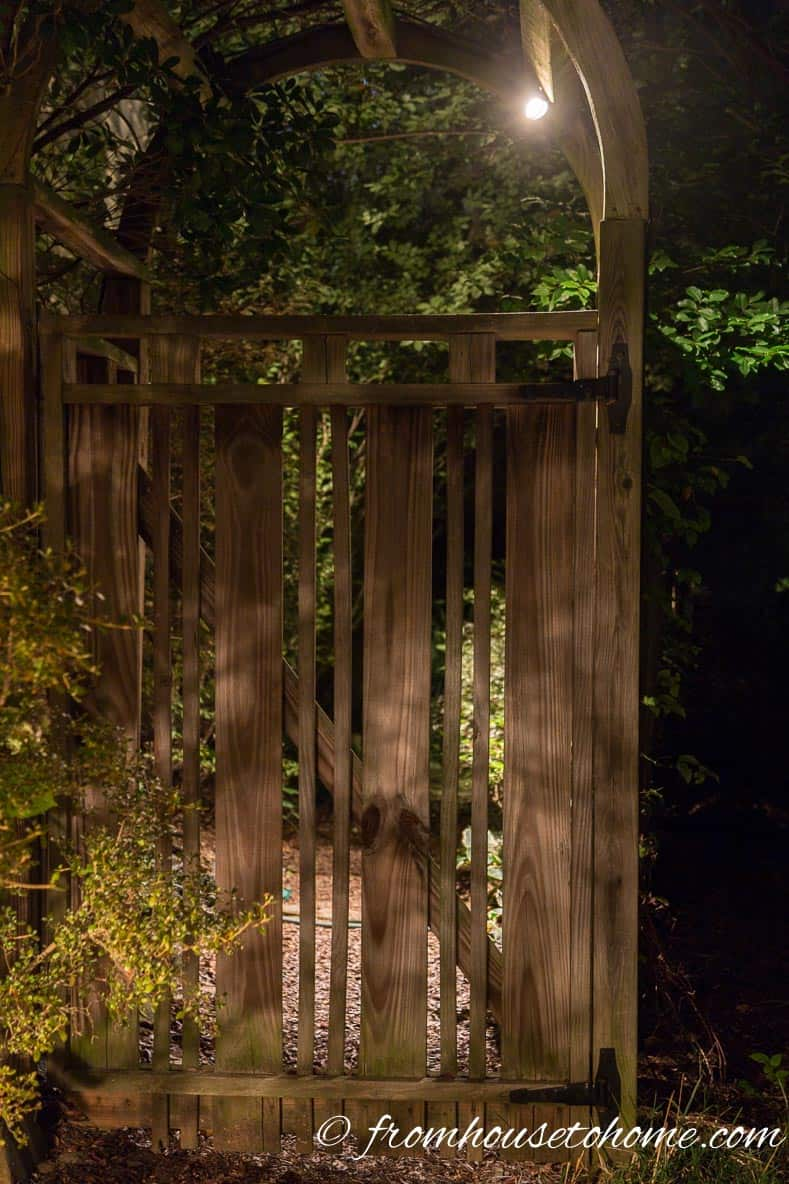 Downlighting an arbor is an easy way to light the sidewalk | How To Design And Install Landscape Lighting
