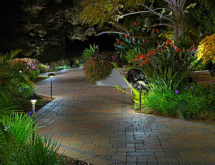 Stagger pathway lighting so it isn't in a straight line, Photo by System Pavers | 8 Landscape Lighting Effects and How To Use Them