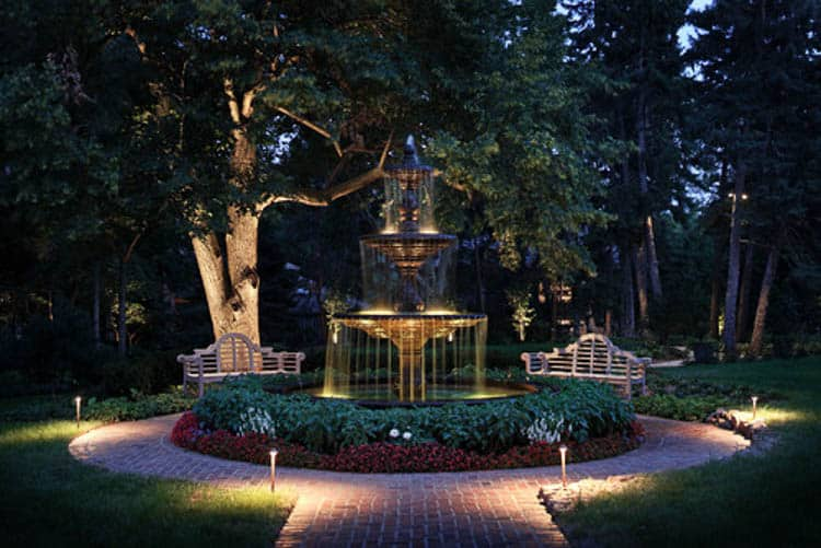 Submersible landscape lights make a water fountain glow at night, via houzz.com | 8 Landscape Lighting Effects And How To Use Them