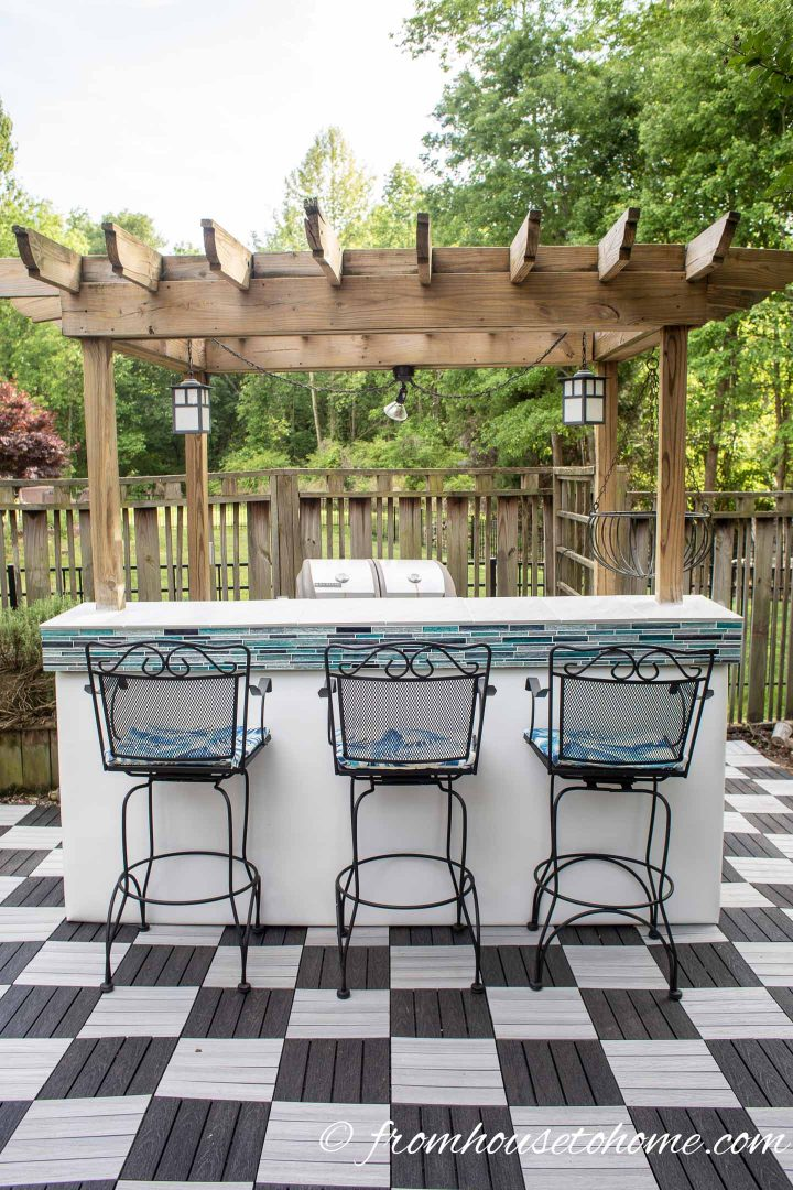 Outdoor bar with black and white checkered pattern deck tiles