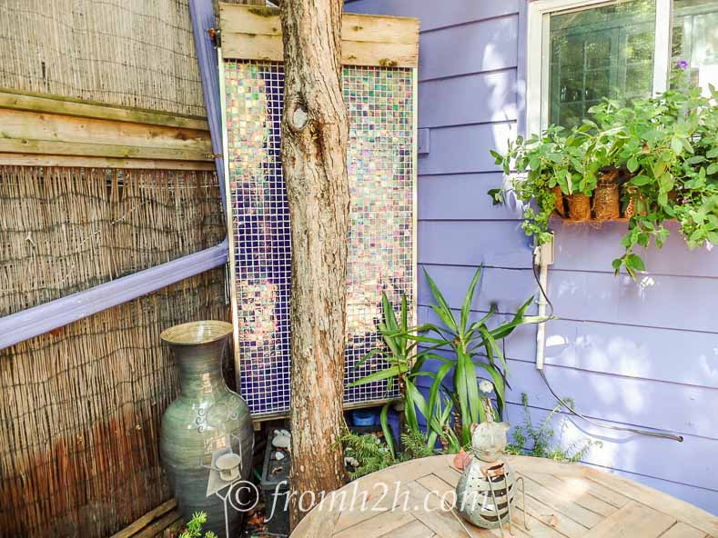 The mosaic tile wall fountain provides soothing water sounds | How To Create a Relaxing Deck