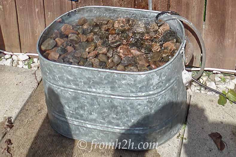 Use a tub to catch the water | Easy Ways To Add Water To Your Garden