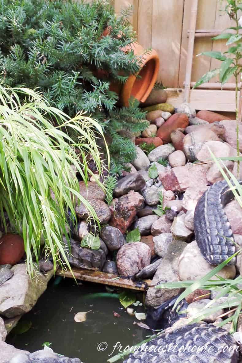 The water falls from the clay pot to the mini pond | Easy Ways To Add Water To Your Garden