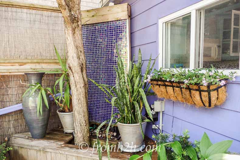 Add a wall fountain | Easy Ways To Add Water To Your Garden