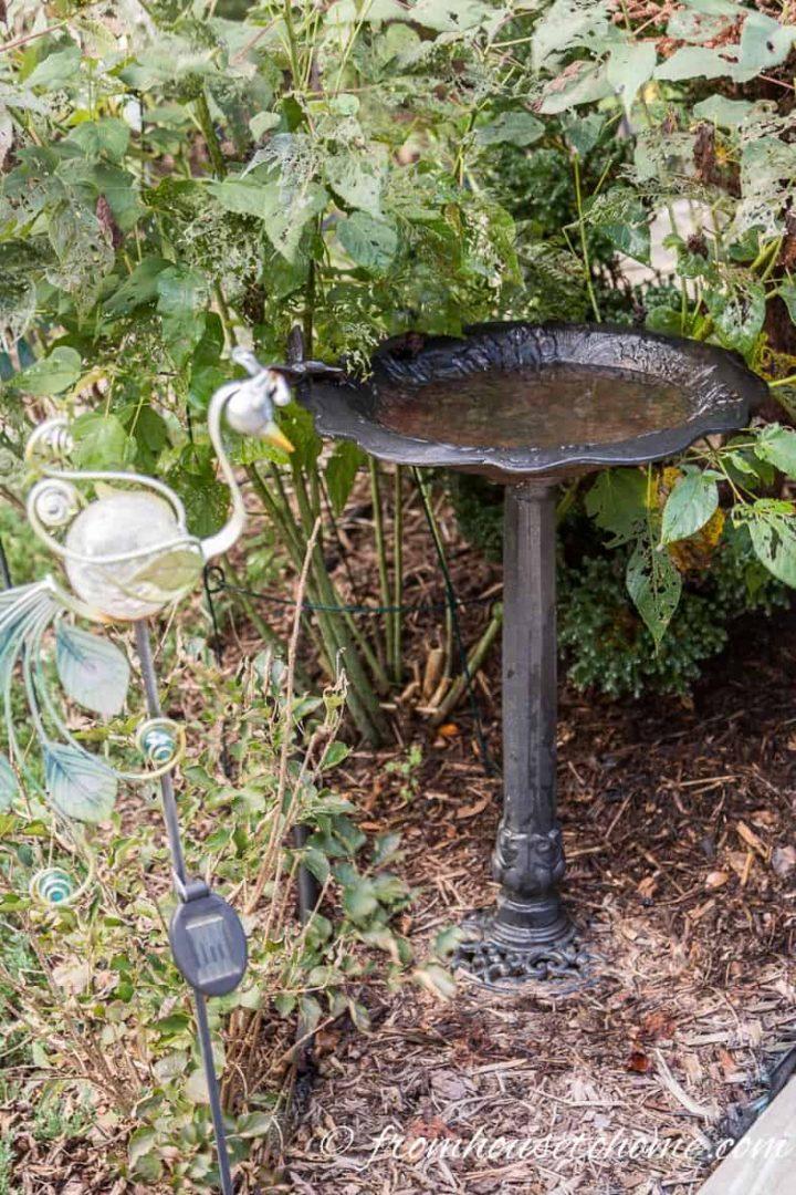 Wrought iron birdbath in the garden