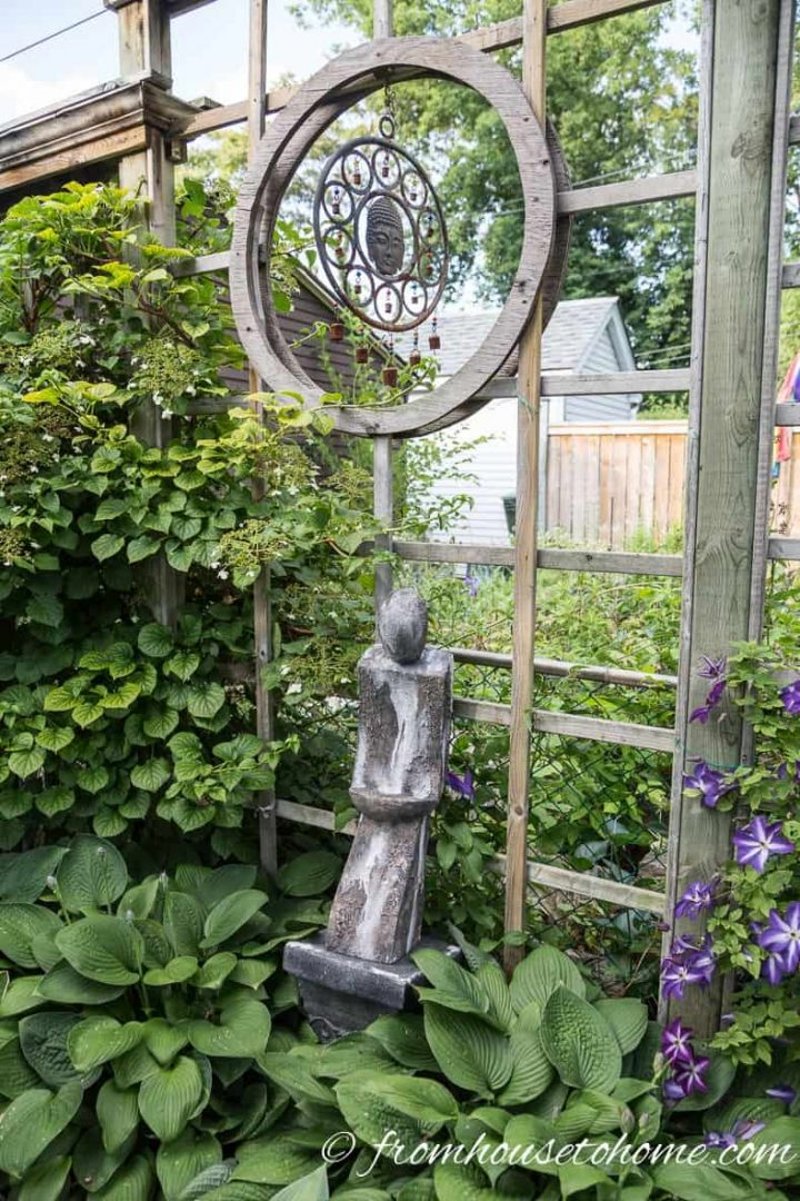 Wind chime above a statue in the garden