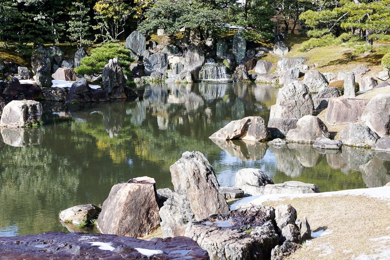 Japanese garden pond with large rocks