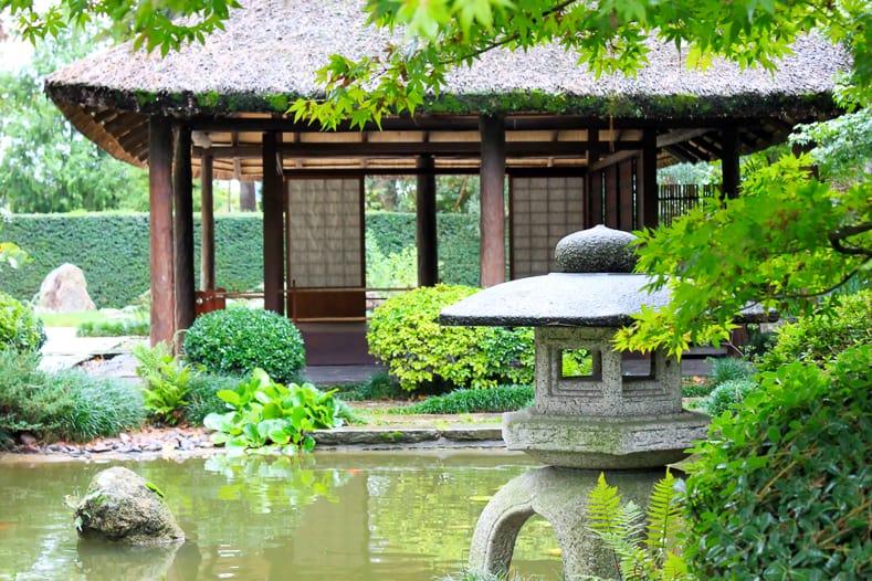 A stone lantern near the tea house in a Japanese Garden