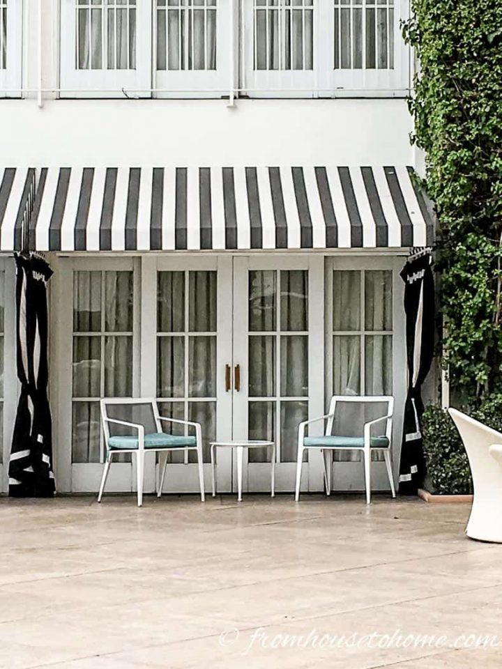 Beverly Hilton poolside room with black and white awning
