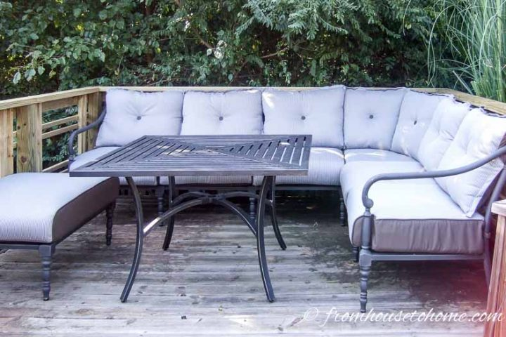 Outdoor sectional sofa on a deck with a square dining table