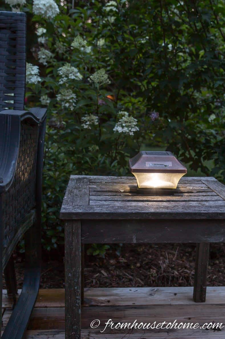 Post light used as a table lamp | 8 Landscape Lighting Effects And How To Use Them | Whether you're looking for DIY landscape lighting ideas for your front yard, backyard or walkway, this list will help! It shows you lots of ways to use both low voltage and solar lights in your garden or patio.