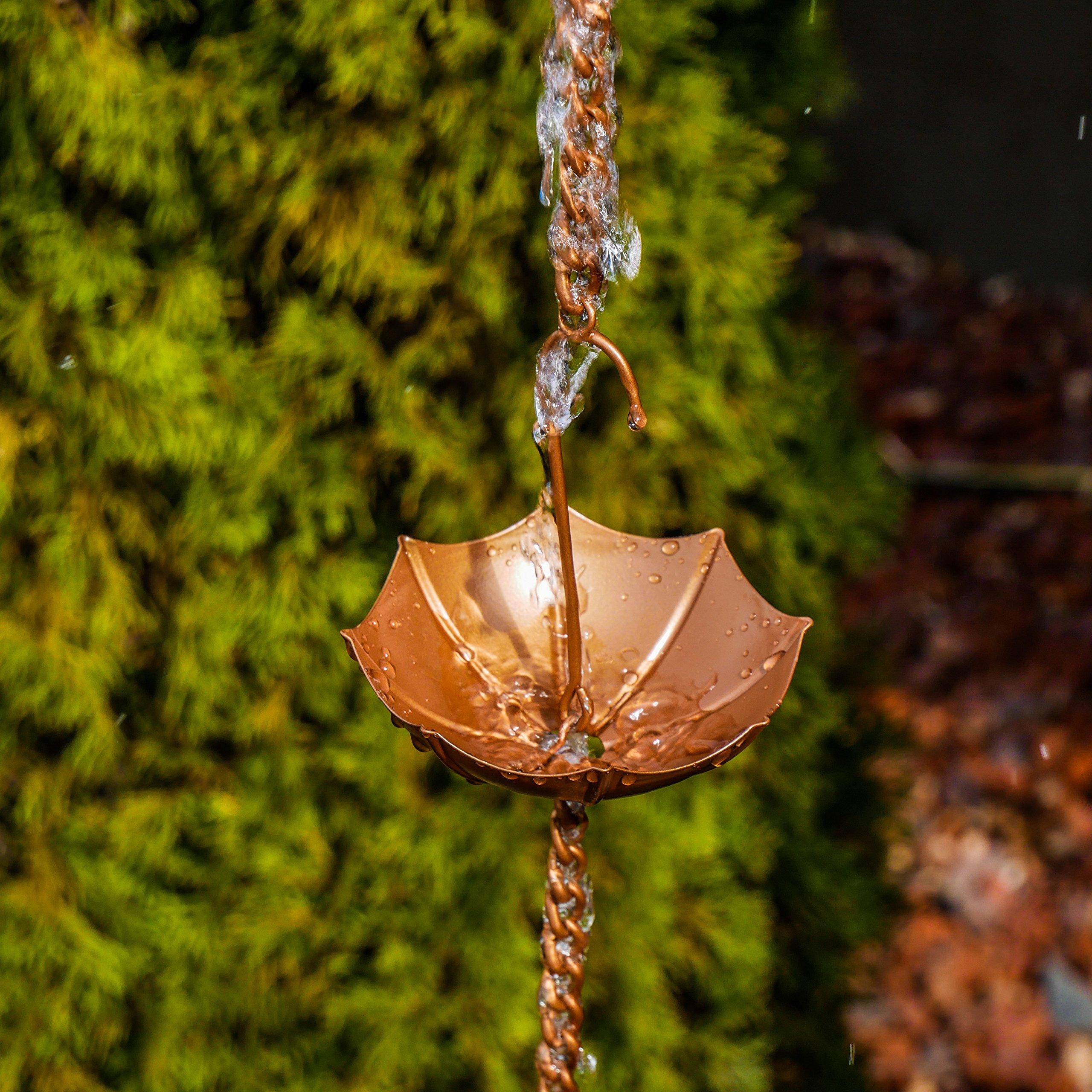 Umbrella rain chain with water running down it