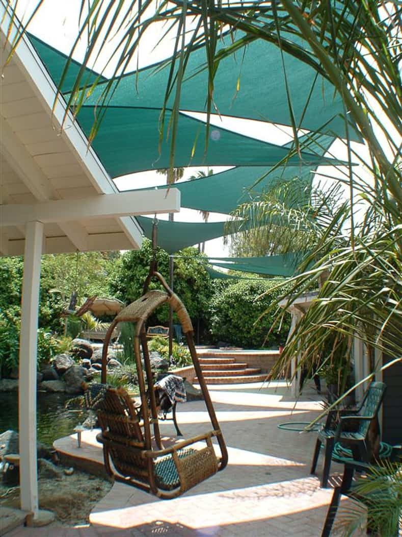 Shade sails provide backyard shade for this patio by shadesails.com