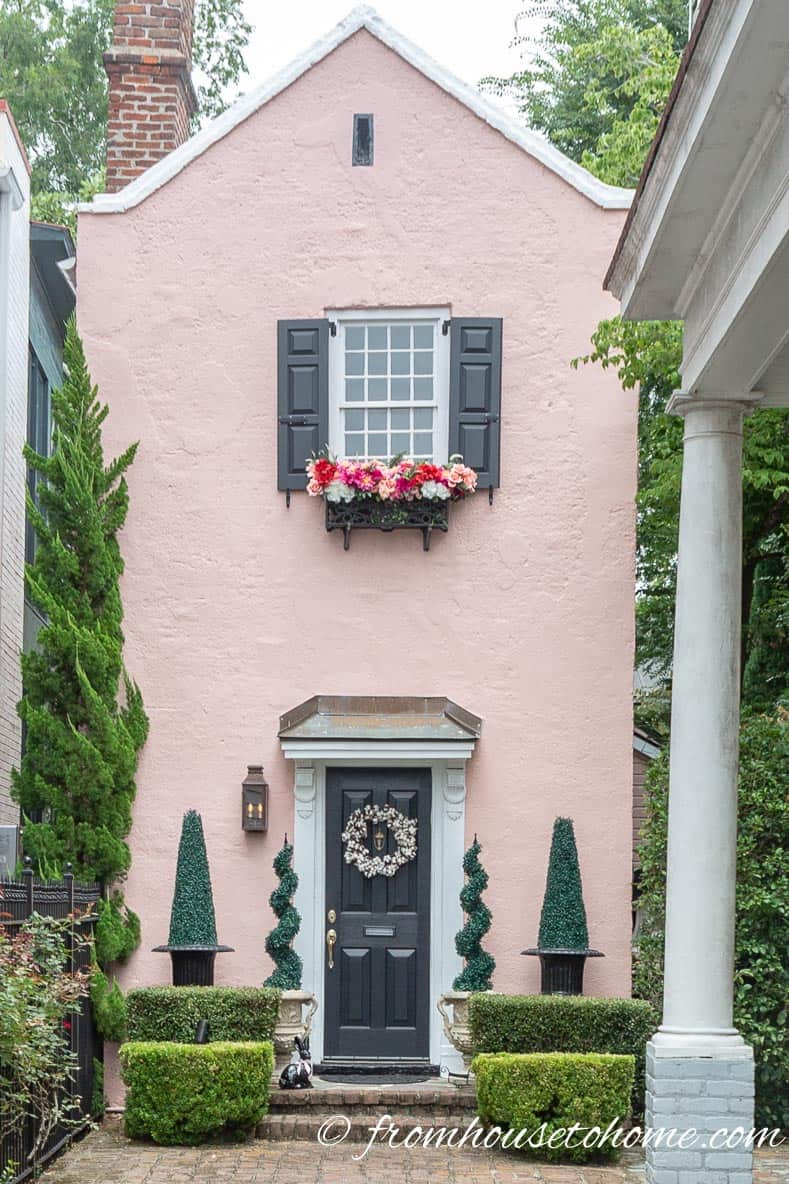 Pink house with window box flowers