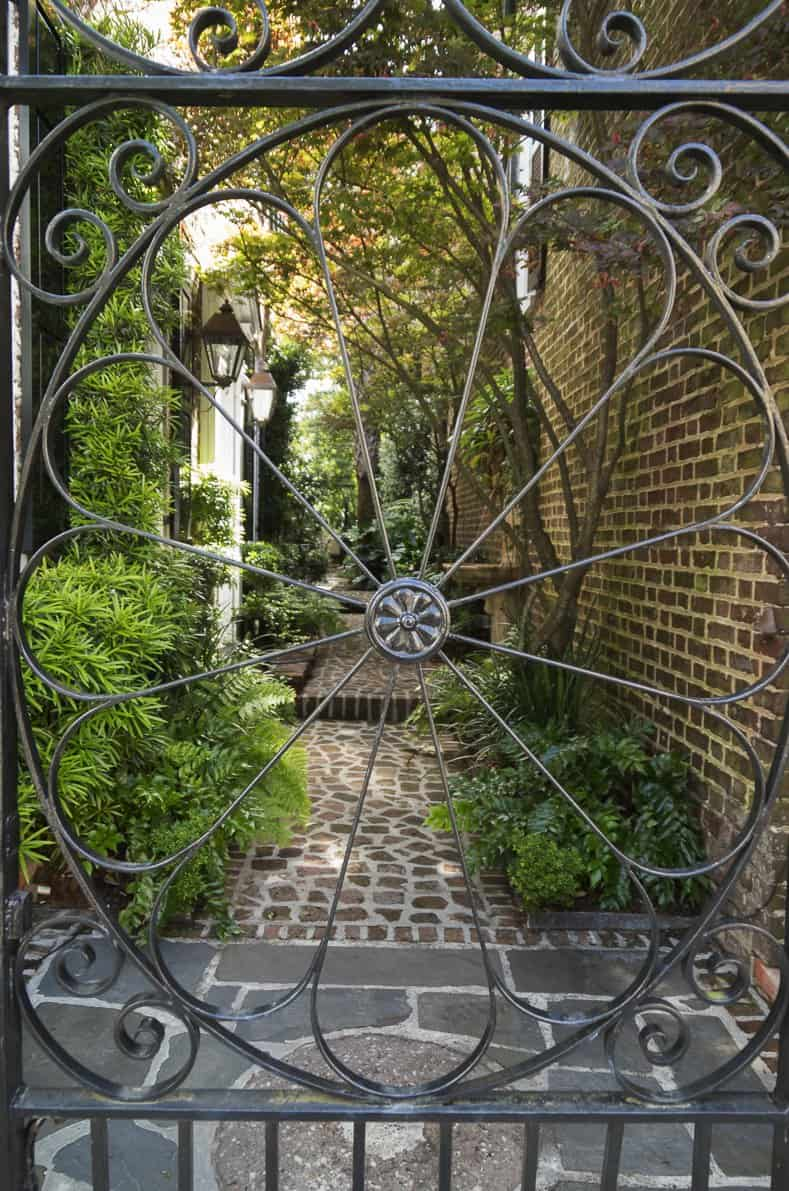 Wrought iron gateway to Charleston secret garden ©balashark - stock.adobe.com