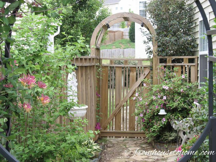 Custom wood privacy fence with a round arbor