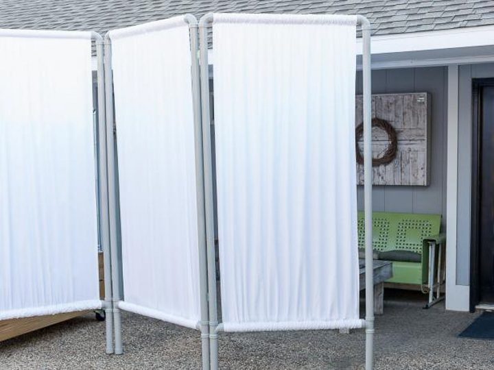 DIY fabric privacy wall made from PVC pipes via hgtv.com