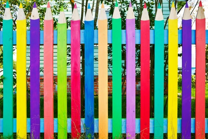 Whimsical privacy fence made to look like pencils ©Dmitry Kushch - stock.adobe.com