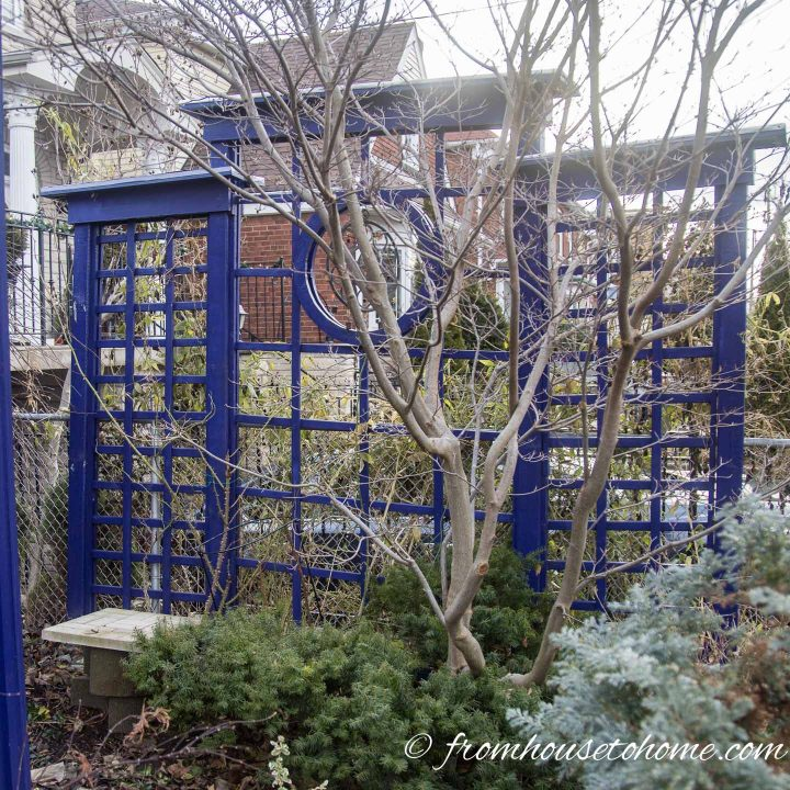 Blue trellis privacy fence with circle cutout