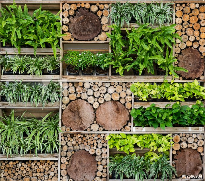 Tall vertical garden alternating wood logs with plants ©marchsirawit - stock.adobe.com