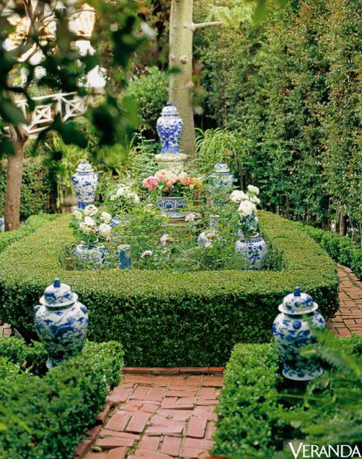 Blue and white ginger jars in the garden by Mary McDonald, via Veranda