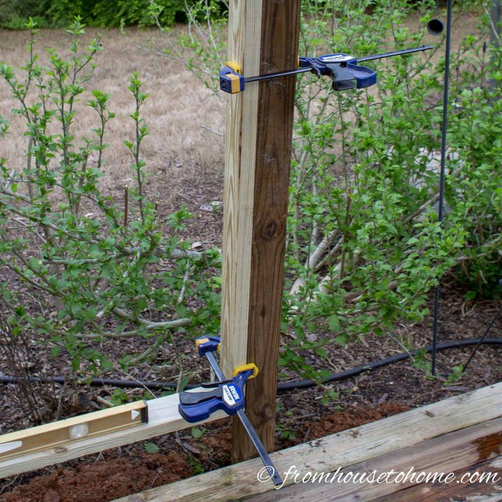 Clamps make sure the boards in the privacy screen frame line up with the posts correctly