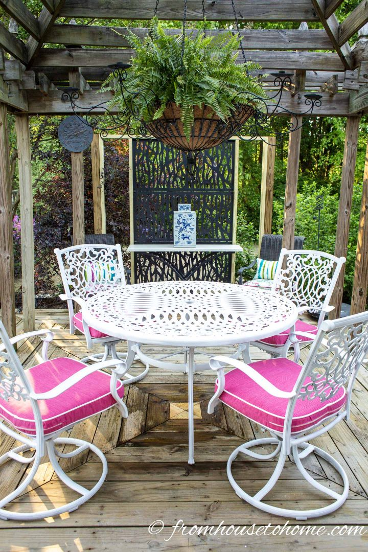 White painted metal patio furniture on a deck