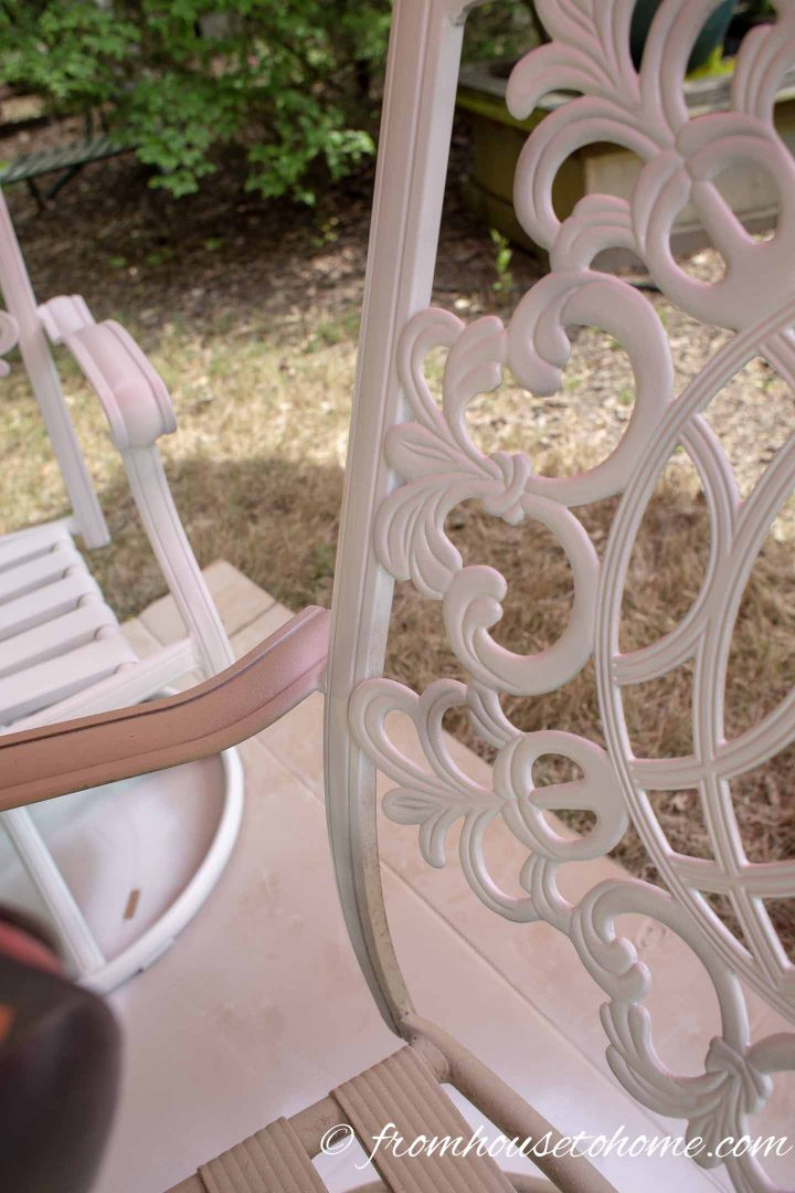 The rail of a metal patio chair that was missed in painting