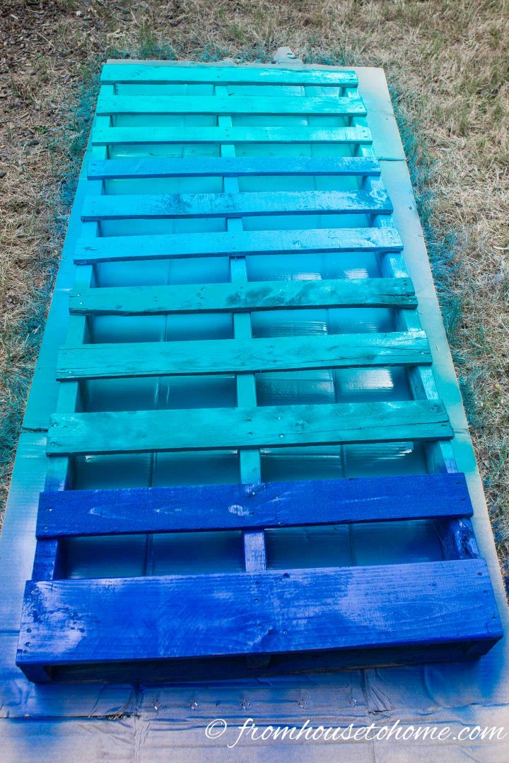 Pallet painted in a blue ombre pattern