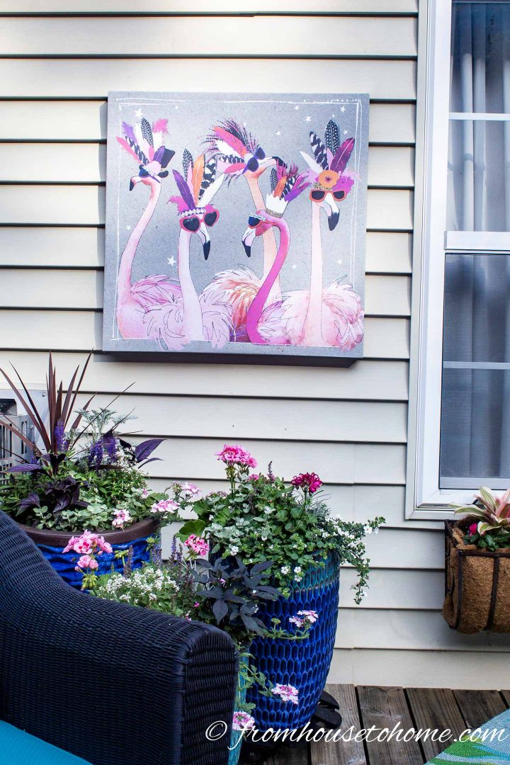 Inexpensive painting of flamingos hung on exterior house wall