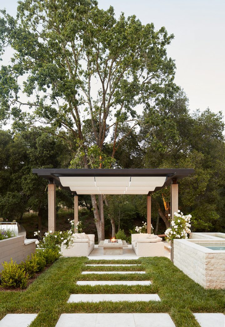 White canvas stationary canopy as pergola cover over patio