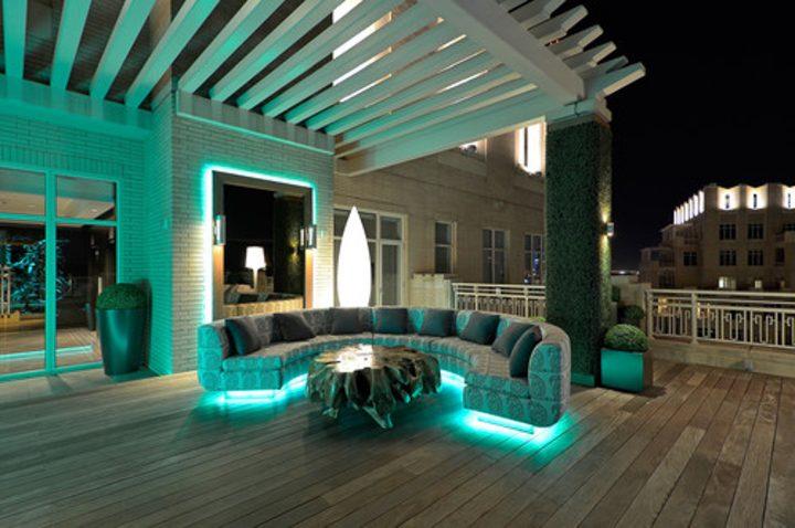 Pergola with modern LED rope lights under sofa