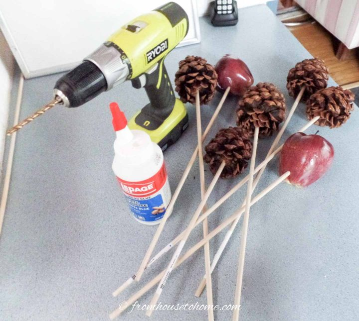 Supplies for making pine cone and faux apple picks