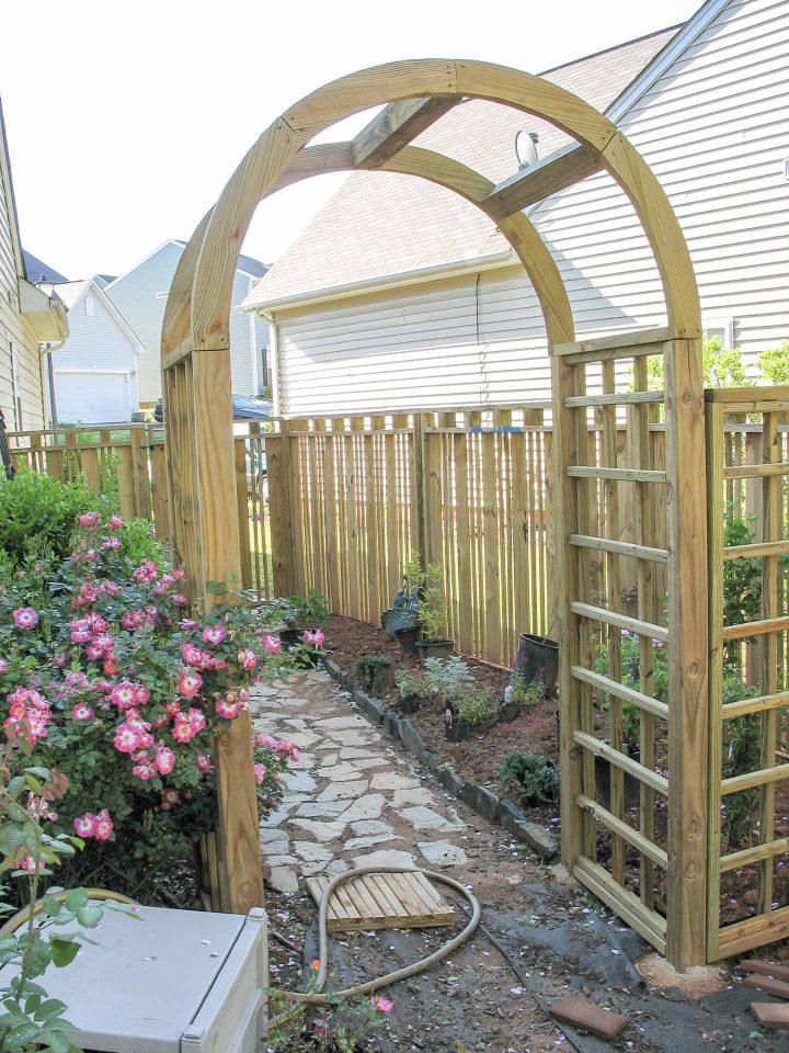 DIY custom wooden fence with an arbor