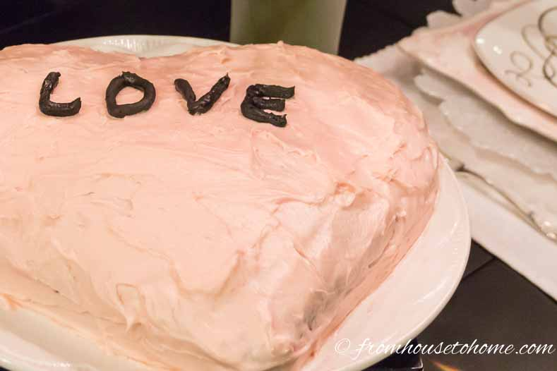 Cream cheese icing with a little red food coloring makes the perfect Valentine's Day heart-shaped cake