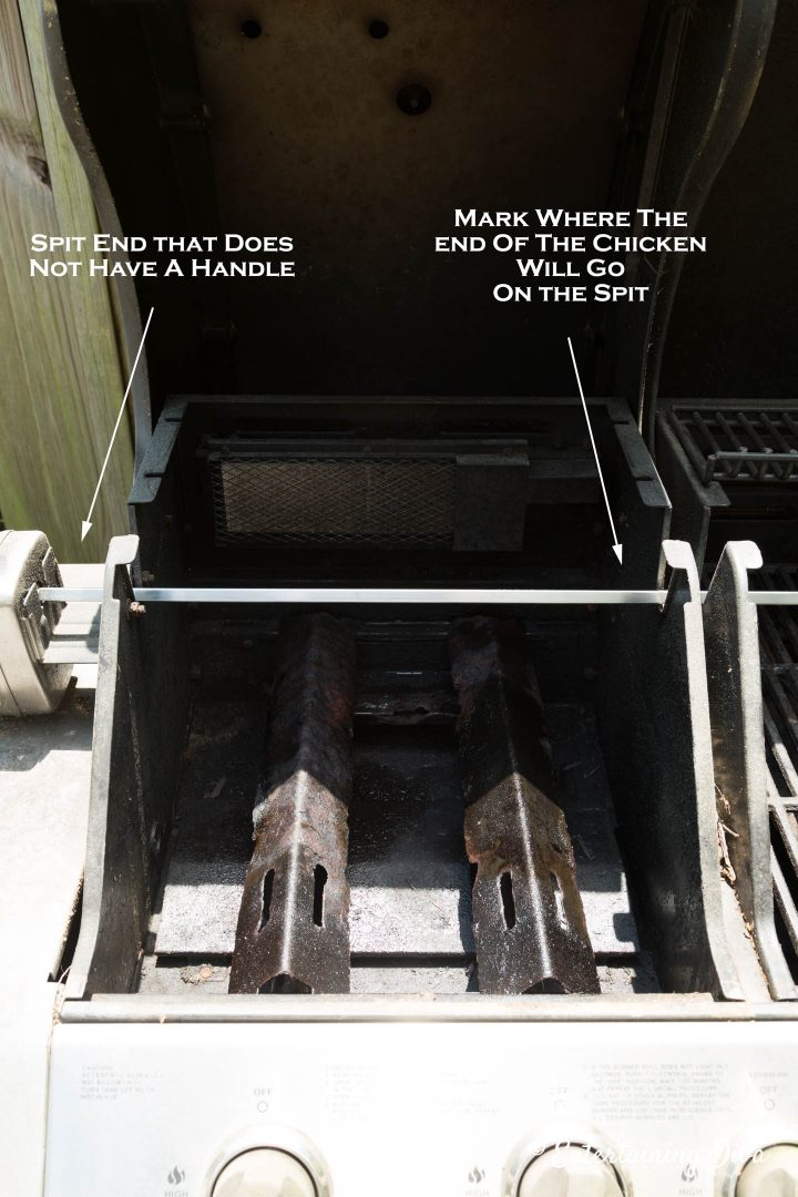 Figure out where the end of the chicken will go on the spit
