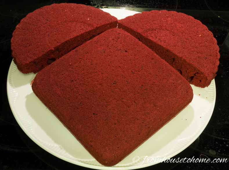 Position the half round cakes on the flat edges of the square cake | How to make a heart shaped Valentine cake - I am by no means a talented baker, but even I can make this simple heart shaped cake! So if you are looking for desserts for your Valentine's Day romantic dinner, this cake is sure to turn out.