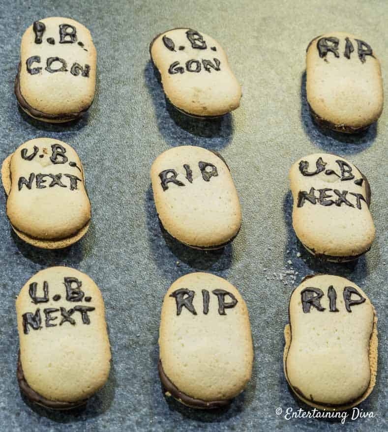 Tombstone cookies with chocolate writing
