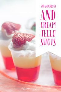 strawberries and cream jello shots with whipped cream garnish