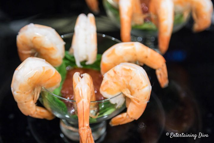 Shrimp cocktail in a glass with lettuce and cocktail sauce